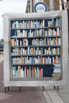 Bookshelf Quilt - Pieced and embroidered by Crimson Tate's community of literary lovers. Quilted by Benji Benjamin of Dancing Gekko Studio.