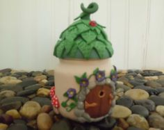 Fairy or elf house treasure jar, candle holder with round fairy door, one of a kind, handmade using polymer clay and recycled baby food jar