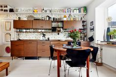 A nice 'String' kitchen - ikea hack - to look like a mid-century scandinavian string cabinets.