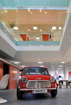 Nothing says British better than the original 1960s Mini Cooper and that's exactly what Rackspace wanted clients to see when they walked through the doors of their UK HQ.   We took the theme even further and decided to place British icons around the office; from iconic red phone booths as quiet call rooms to installing a mural of London's skyline across the wall of the staff cafe and even theming one of the meeting rooms with the external facade of 10 Downing Street.
