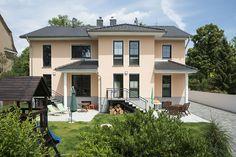 Glücklich im neuen Haus am angestammten Familiensitz - http://www.immobilien-journal.de/hausbau-nachrichten/hausbau-tipps/doppelhaus-von-roth-massivhaus-in-berlin-lichterfelde-gluecklich-im-neuen-haus-am-angestammten-familiensitz/