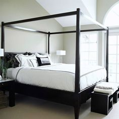 Modern Oasis: An abundance of natural light shines off this modern bedroom's black-and-white surfaces. Beige walls and white linens give via bhg.com