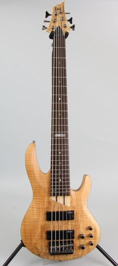 The 6 string version of the popular B-200 series bass guitars by ESP LTD. The B series basses from LTD have been a long standing member of the LTD lineup, and for good reason. The unique wood and fini                                                                                                                                                                                 Más