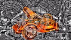 Custom painted gold hot rod on a black and white background of the Royal Exhibition building in Melbourne, Australia