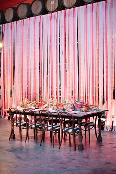 Hide boring walls with ribbon at your wedding venue.