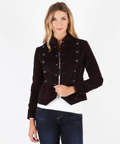 This cool-girl jacket features black hardware details and an edgy stand collar. A military-inspired silhouette completes the look.