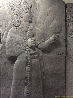 Carchemish, Long Wall's reliefs, ca 950-850 BC. Kubaba, Hittite Queen of Sumer, holding a pomegranate in her right hand and a mirror in her left. Museum of Anatolian Civilizations, Ankara