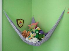 My oldest daughter's stuffed toy hammock!  LOVE this pattern!