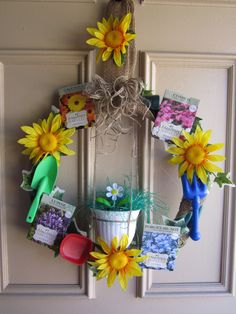 Solar Flower/Gardening Wreath= Made with a water hose for the basic round wreath