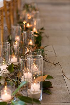 ceremony aisle candles. Photography by candicekphotography.com.