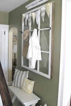 Crafty entry way.  You can write reminders on the window panes with dry erase marker, or put pictures in back of others. ;)