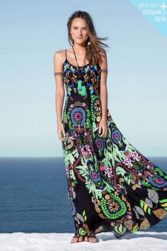 www.farmrio.com.br Inacredibly beautiful maxi by Farm Rio. Love the tassel necklace and armbands too.