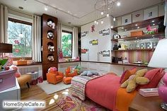 This is absolutely stunning! Bright, modern and so, so colorful. One of my favourite pieces is that wooden closet where the toys are trying to hide away from the kids, and those really small and cute orange sofas, placed right in the middle of the room.