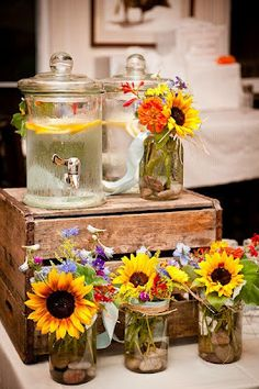 Pretty display for a summer wedding or you could use it for any party. (I like the flower displays, simple glass with the stones in the bottom)