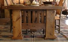 I love the BIG legs on this reclaimed wood table.