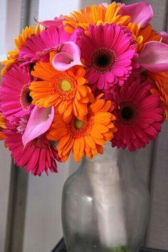 Bright & Cheerful Wedding Bouquet Which Includes: Hot Pink Calla Lilies, Hot Pink Gerbera Daisies & Orange Gerbera Daisies••••