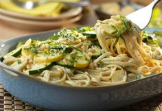 This fabulous pasta dish features zucchini, yellow squash, toasted pine nuts and linguine tossed in a delectable basil pesto Alfredo sauce. It's incredibly good and sure to become a pasta night favorite!