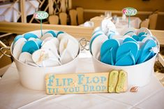 Flip flop til you drop!   Wedding reception Flip Flop Bucket for Guests. Photo by Lisa Goodwin Photography.