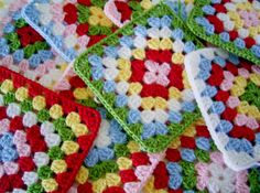 Cath Kidston style granny squares...This is the basis of my red lap blanket. ::Jo::