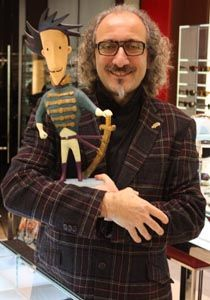 "Alain Mikli avec la statuette ""Prince de Sassoun"" by Alban Guillemois --French eyeglass maker-with prized possession"