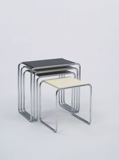 Marcel Breuer, Nesting Tables (model B9), 1925-26. Chromium-plated tubular steel and lacquered plywood. Courtesy MoMA