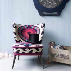 Be the sultan of style with our colourful suzani print chair & footstool. With it's cool 50s shape, and tapered wooded legs it will add real bravura to your interiors.