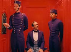 Milena Canonera's costumes, here employing an unusual colour pairing such as tomato red and violet.  Scene from The Grand Budapest Hotel by Wes Anderson.
