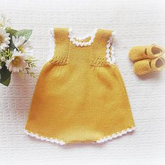 Straight out of the seventies. The most adorable hand knitted baby onesie and matching yellow booties. Such a cute outfit for a baby girl with some knitted tights 💛 Knitting For Kids, Baby Knitting Patterns, Crochet For Kids, Baby Outfits, Baby Barn, Stylish Summer Outfits, Baby Pullover, Knitted Baby Clothes, Baby Sweaters