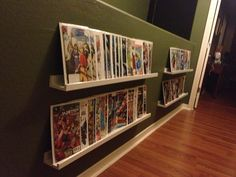 Picture ledges (from Ikea) to hold books in a narrow hallway.