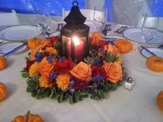 Fall Wedding Centerpieces with Lanterns give us light, but the flowers need to be simpler...