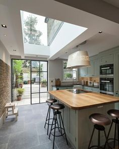 what we like: exposed brick, sky light, iron & glass door, doors out in to garden, kitchen island
