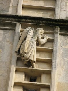 One of several angels climbing Jacob's Ladder on the exterior of Bath Abbey, Somerset, England.  What a neat idea!