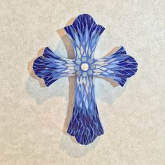 This shimmering mosaic wall cross is unique Christian wall art; a decorative cross that uses tones of sapphire and ocean blue and is a striking example of mosaic art elegant in any type of Christian decor. This hand cut mosaic uses a special Paintbrush Cut, which feathers out different Blue Mosaic, Mosaic Wall, Mosaic Glass, Christian Crafts, Christian Decor, Christian Quotes, Crosses Decor, Wood Crosses, Diy Christmas Crafts To Sell