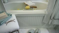 This, but with subway tile -- Give Your Bathtub a Custom Look with a Beadboard Panel