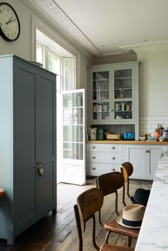 A beautiful big pantry cupboard painted in 'Trinity Blue' with brass details