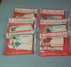 Vintage lot of 6, $0.10 Christmas strung tags ( sealed )