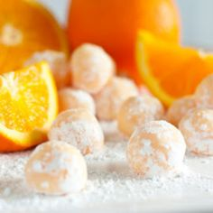 Orange Creamsicle Truffles 1/4 cup butter zest of 1/2 orange 3 tbsp heavy cream 1 cup white chocolate chips 1/2 tsp orange extract 1/4 cup powdered sugar red and yellow food coloring (optional)