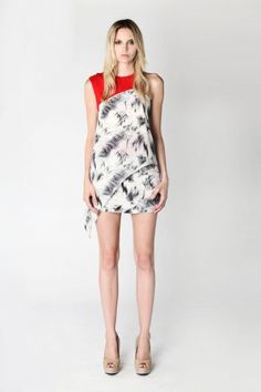 """This Spring you must own one, or two, or maybe three, at least, asymmetrical pieces. I love this """"Stella and Jamie"""" top. In one piece we have the asymmetrical, abstract pattern and pop of color trends."""