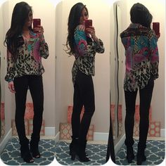 Drape front shirt Fun and colorful hi-low shirt with black crocheted accents. Women's size XS. It is missing a button on the right sleeve (wrist area). Bisou Bisou Tops Blouses