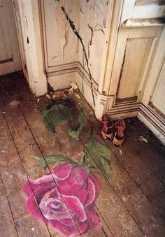 vintage DIY rose on exposed wood floorboards