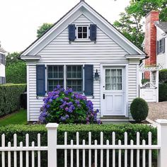 The hydrangeas make the perfect addition to this cozy little cottage.