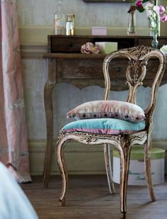 Lovely French antiques and pillows. Old world colors and details, as well.
