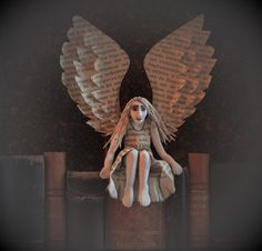 Book guardian.(paper clay, old books) Johanna Hulkko