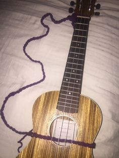 DIY Crocheted Ukulele strap. Easy. Just chained until it was as long as I needed. Red Heart yarn.