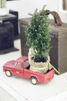 Nothing says Christmas like a red truck with a Christmas tree