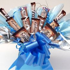 A bouquet of Galaxy chocolate bars arranged to create a stunning galaxy chocolate gift for him with blue bow and blue cellophane, next day delivery UK. Candy Bouquet Diy, Diy Bouquet, Bouquets, Chocolate Hampers, Chocolate Gifts, Galaxy Chocolate Bar, Chocolate Bouquet, Gifts For Him, Birthdays