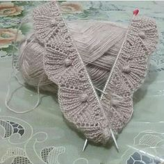 idea for crochet version - bobble or puff stitches at centre of fan stitch