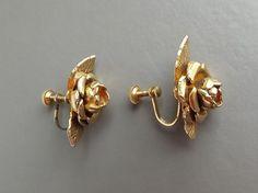 Beautiful vintage 70s flower rose flower clip on gold tone earrings via Curious Nik.