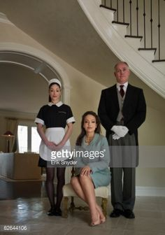 Stock Photo : Butler and maid with wealthy woman.