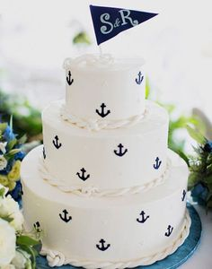 38. Take it to the seas with this awesome nautical cake. Complete with anchor accents and rope fondant we can't get enough. See more of this Nautical Wedding here captured by Christina Szczupak Photography with cake by Sweet Lisa's.